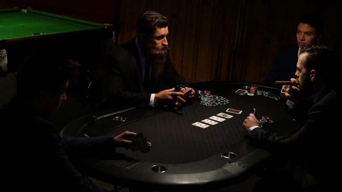 The bearded god plays poker